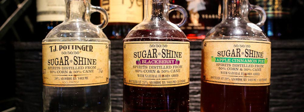 Tre flaskor TJ Pottinger's Sugar Shine